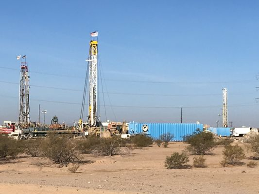 Three Drill Rigs On Site